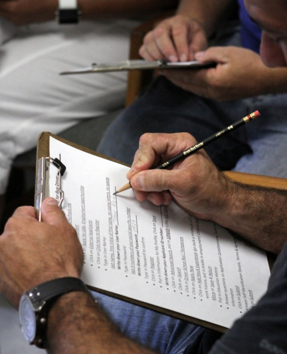 072612 (Photo by Taylor Jones/The Palm Beach Post). WEST PALM BEACH. Applicants fill out paperwork. The School District of Palm Beach County's Department of Transportation is encouraging job seekers to apply for school bus drivers at a jobs fair at its Central Transportation Facility on Summit Boulevard in West Palm Beach Thursday. In addition to exceptional retirement benefits, competitive pay and health insurance.